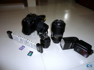 Nikon D7000 With everything See the details and picture.