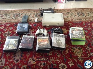 Xbox 360 Arcade with many games and accessories