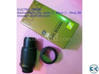 NIKON 55-200mm Lens with hood .