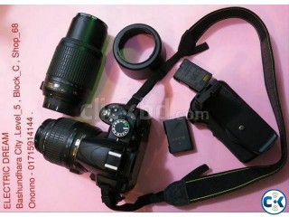 NIKON D 3100 WITH 18-55 mm and 55-200 mm Lens. Battery grip