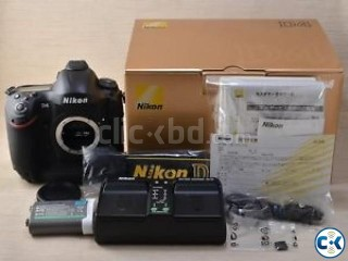 Nikon D4 camera and lens