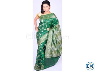 Green opera katan saree.