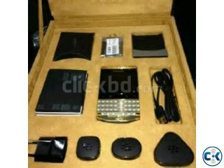 Blackberry Porsche Gold/black with special pin