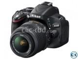 Nikon D5100 SLR Camera With Lance Brand New