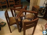 Dining table frame with four chairs
