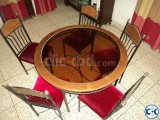 Glass centered round dining table with six chair full set .