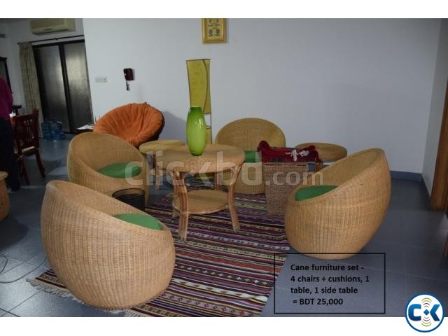 A Set Of Cane Chairs With Big And Small Table