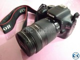 DSLR Canon 550D with 18-135mm lens with waterproof bag