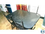 Otobi Original Brand Dining Table with 4 chair black.