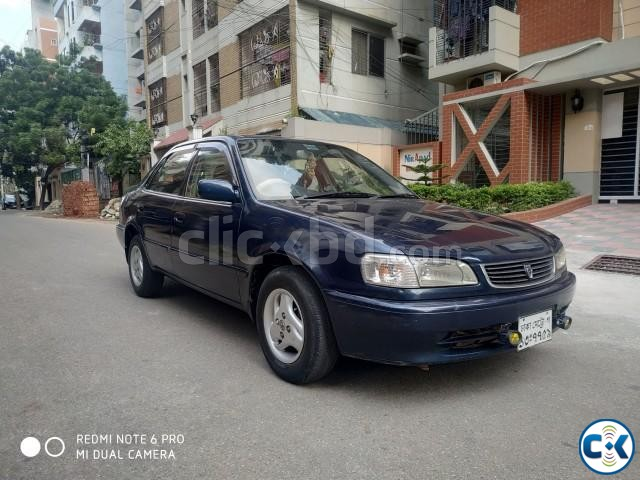 TOYOTA XE SALOON AE110 BLUE 1997 | ClickBD large image 1