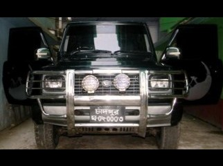 Its a Black manual 4X4 2300CC SUV