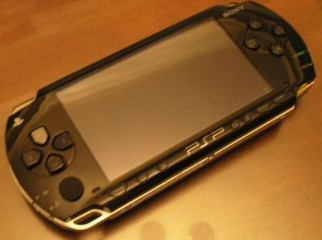 PSP Fat piano black 8 gb included.. cell no 01615698826
