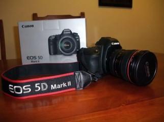 Nikon D7000 DSLR Camera Nikon D90 DSLR Camera Canon EOS