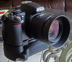 Nikon D3100 With 18 105mm 50 Mm F 1 8 G And Battery Grip