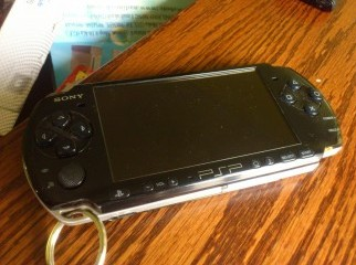 PSP 3000 FOR SALE WITH BOX,CHARGER,COVER AND 4GB MEMORY CARD